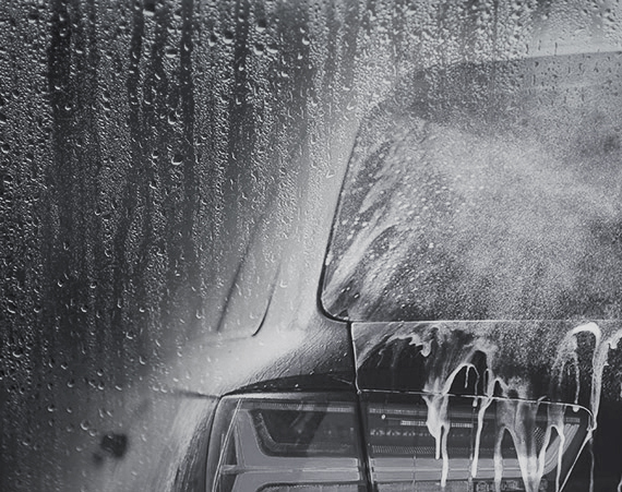 Car going through automatic car wash cycle